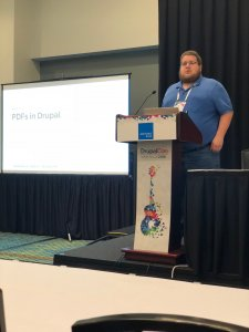 Dan Hansen standing at podium for his talk at DrupalCon Nashville 2018.