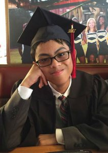 Joseph in graduation cap and gown.