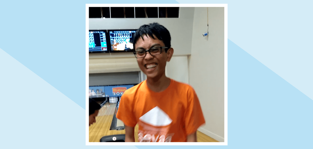 Portrait of Joseph at bowling alley.