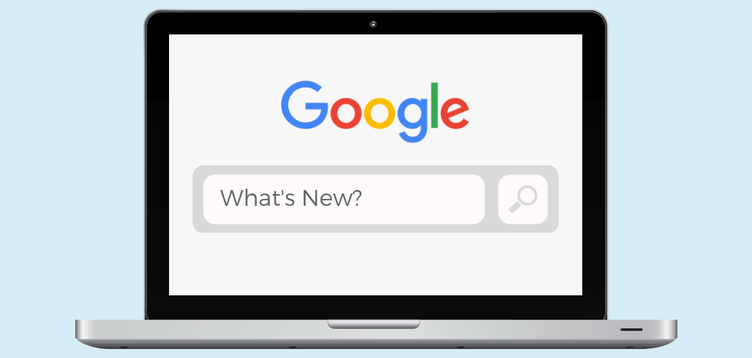 "Laptop with Google search bar with 'What's New?"" typed."