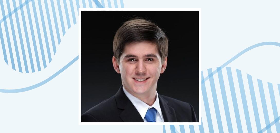 Headshot of Will Allison on blue background.