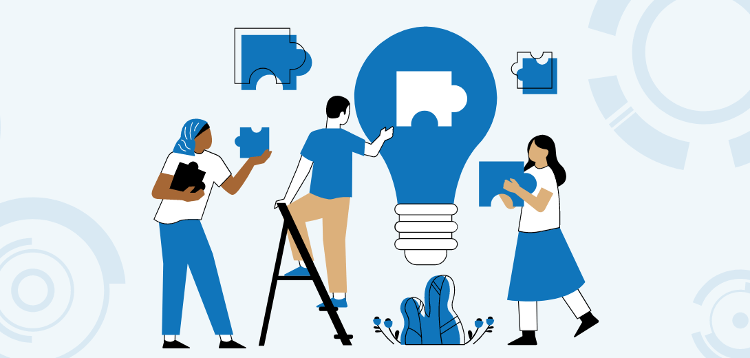Three people holding puzzle pieces in front of blue lightbulb.